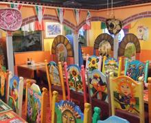 Mexican art chairs adorn dining room